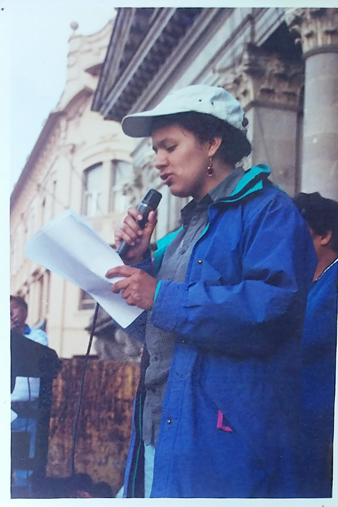 Berta speaking at an event.