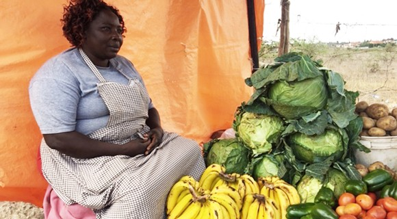 After ripening, bananas make their way to be sold by a street vendors, such as this woman, in Nairobi. Photo courtesy of Peyton Fleming