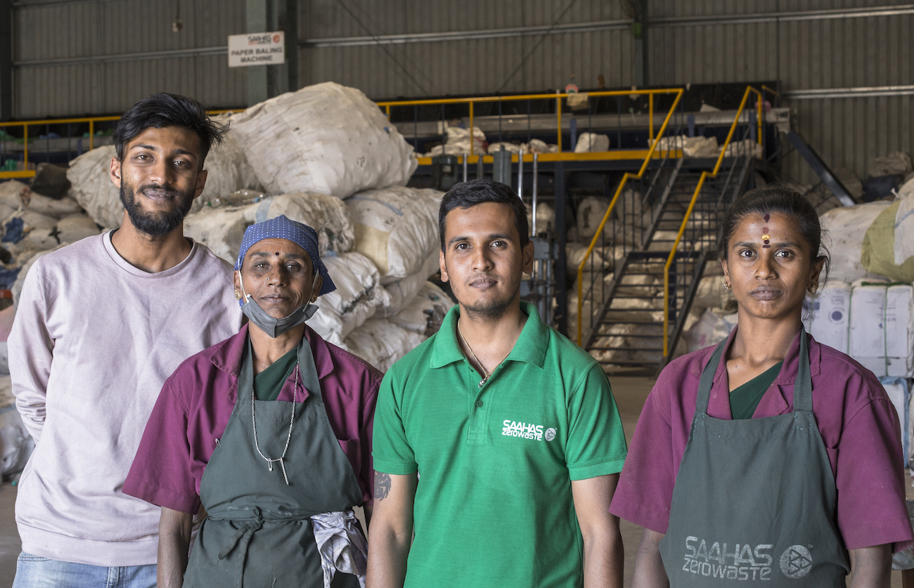 reBalancer Kishan with waste workers at a rePurpose partner facility in Bangalore, India. - © rePurpose Global