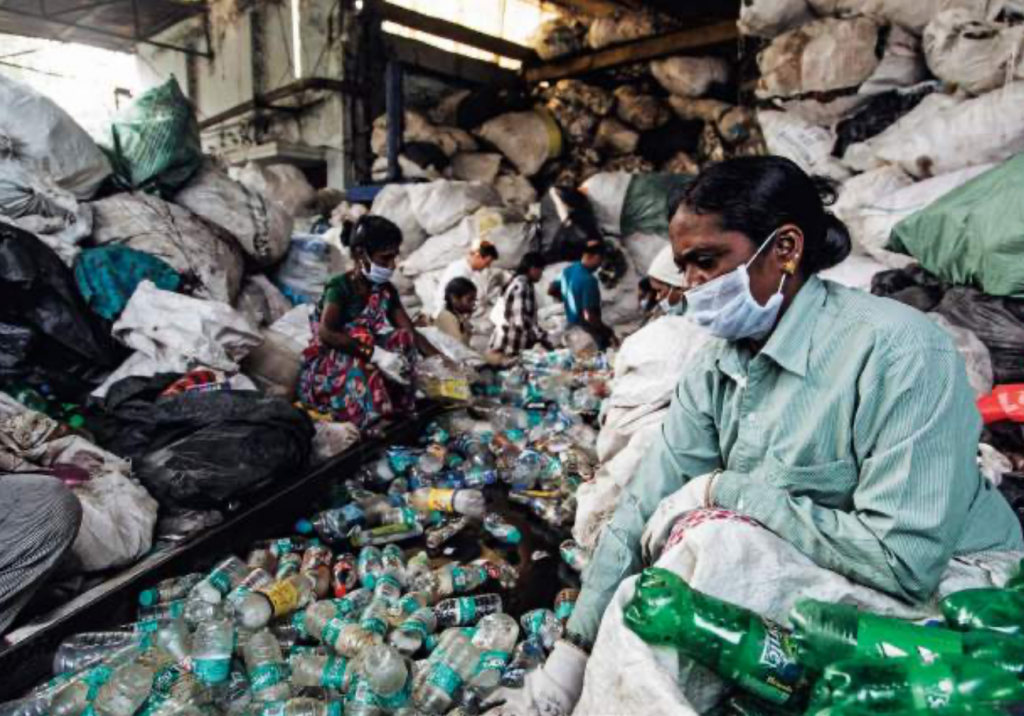 Upskilled waste pickers sorting through plastic in Hyderabad, India.