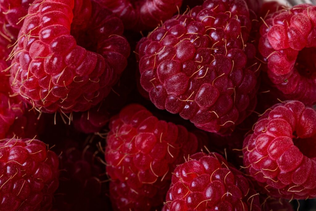 © Rodion Kutsaev. Raspberries are low in calories, rich in vitamins, fibres and antioxidants